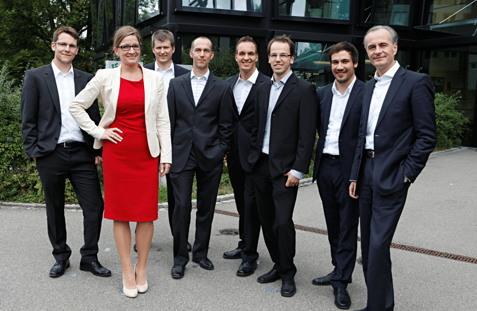 Men in suit and woman in red dress