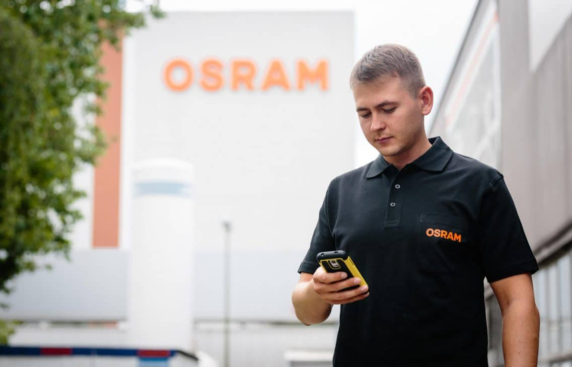 Osram worker looking at his ticket manager he is using for this particular digitalizaton project.