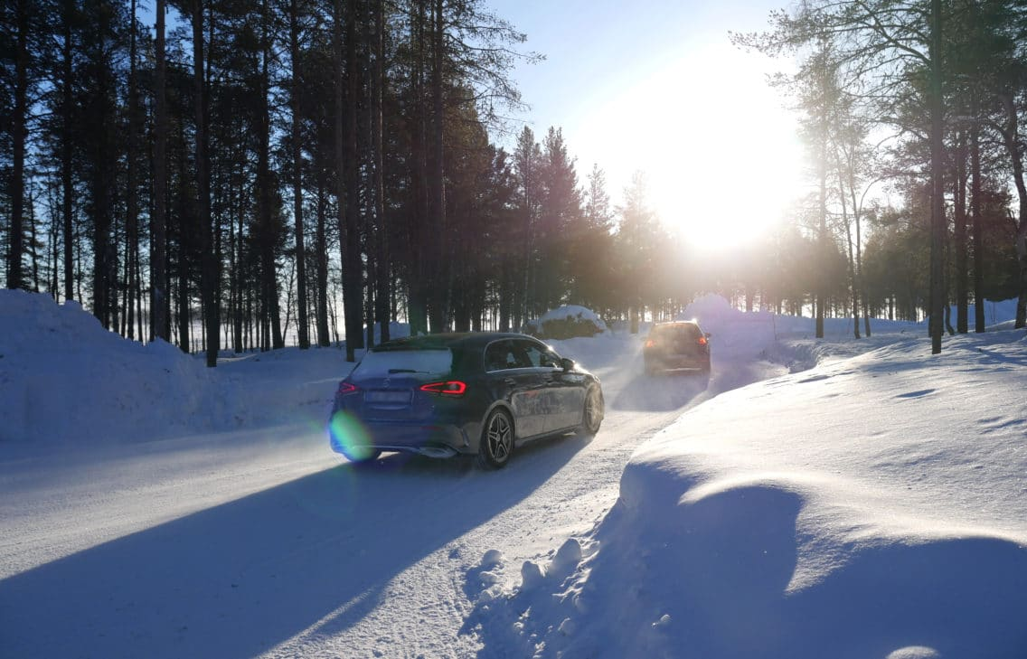 Driving cars in a winter landscape