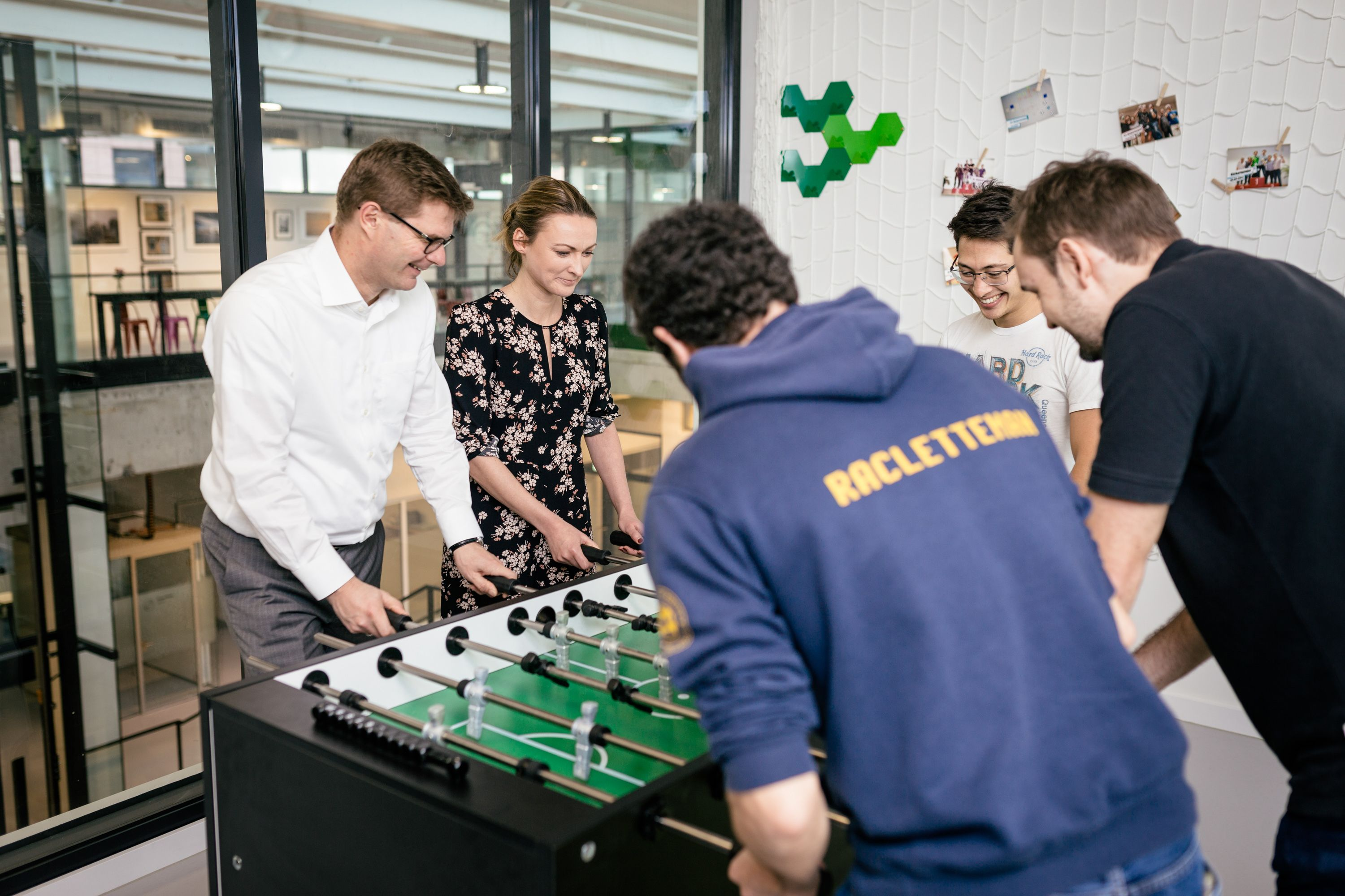 Stefan Ferber and other Bosch Software Innovations staff are playing table soccer at the new Bosch IoT Campus Berlin