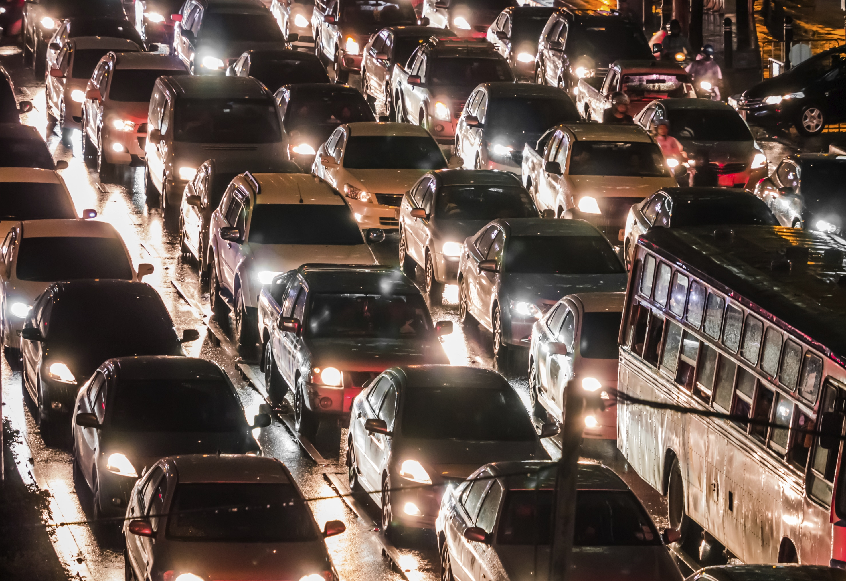 Digital transformation: A crowded street full of cars in India.