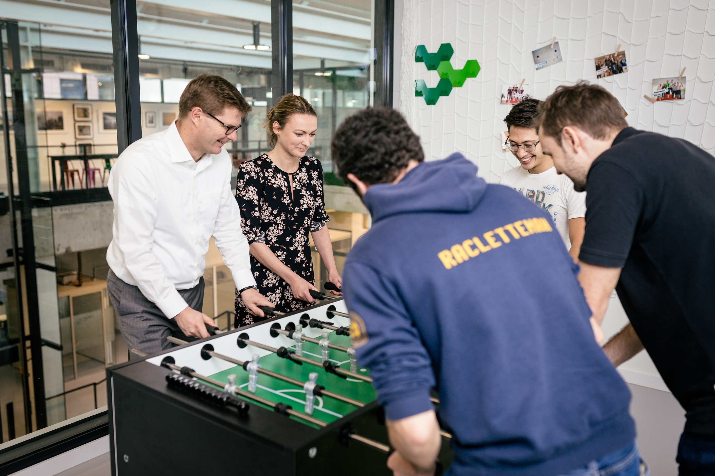 Employees playing table soccer at the modern workplace of Bosch.