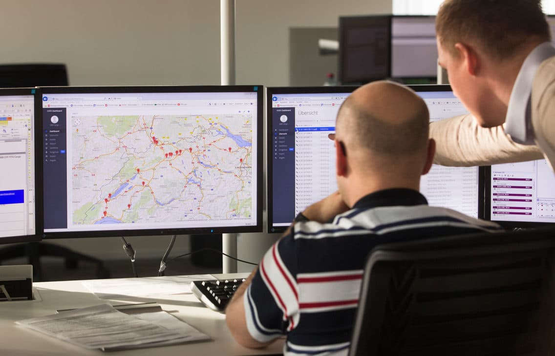 A fleet operator monitoring the status of railway cars on his screen