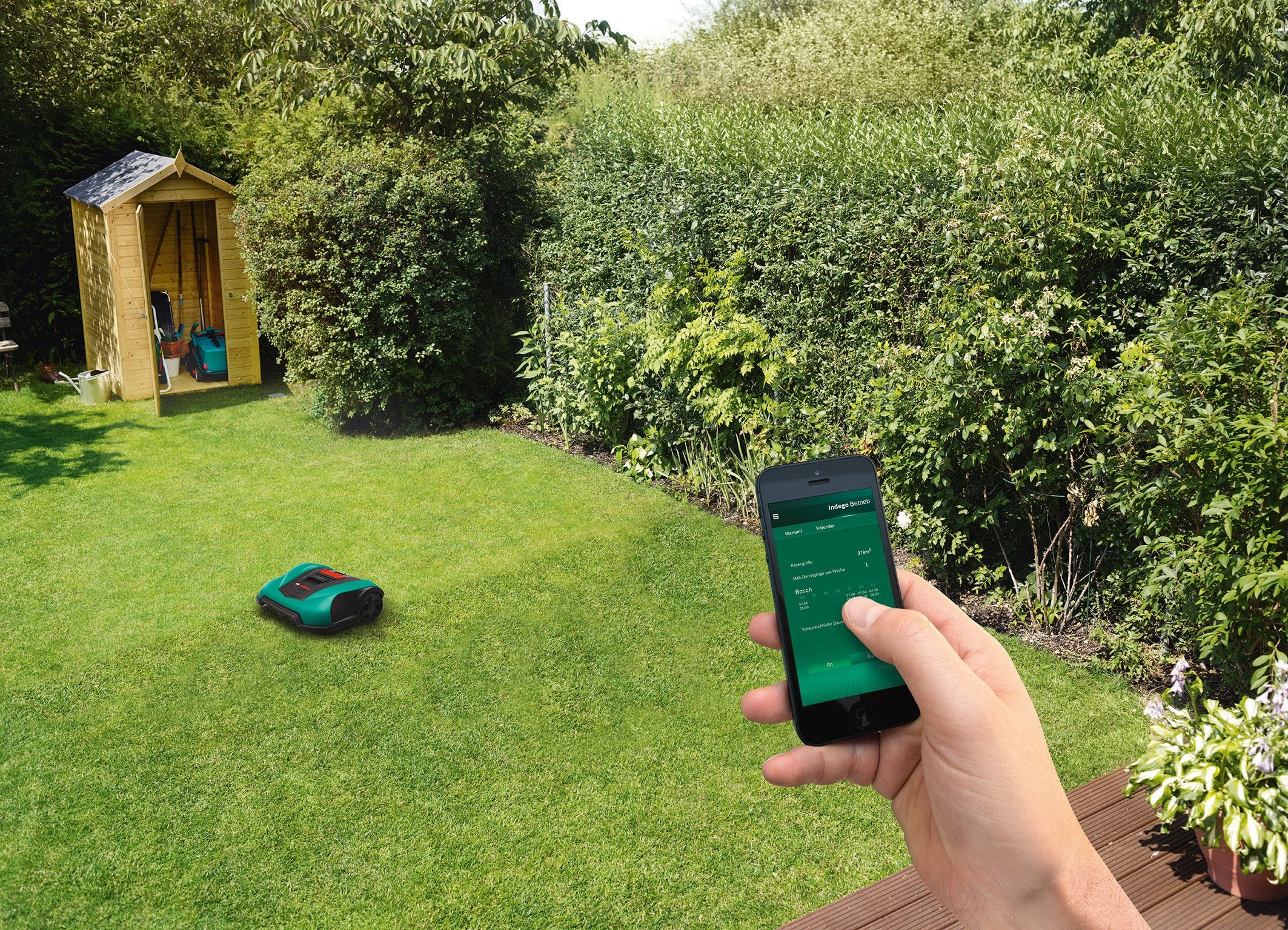 Connected lawn mower Indego and a mobile phone with the user app