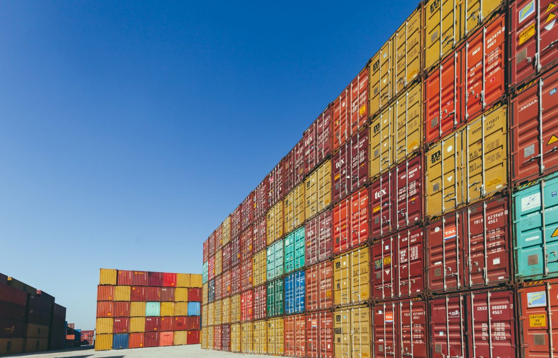 Kubernetes: Stack of colorful cargo containers at the dock