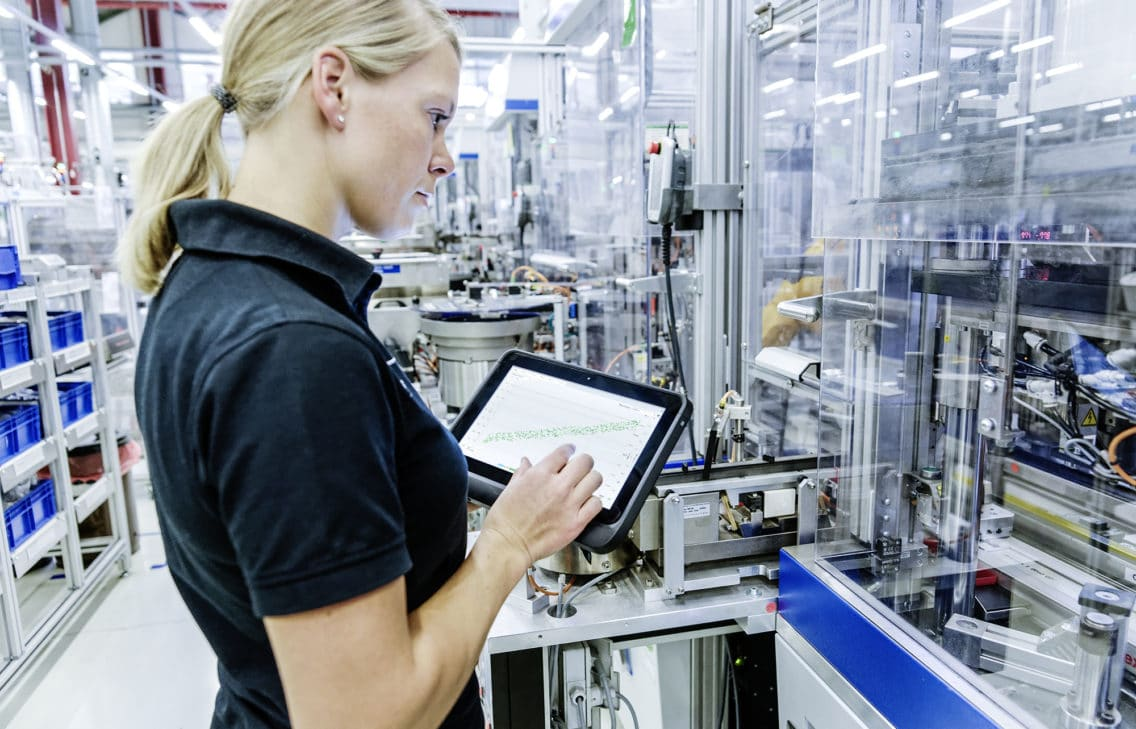 Woman with tablet in lean production