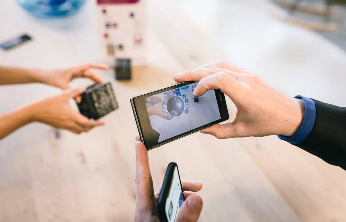 Smart learning environments use mobile phones for augmented reality.